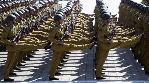 North Korean soldiers goosestep during a parade in Pyongyang.