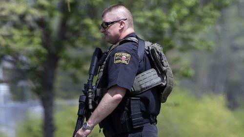 US college in lockdown after employee shot dead by gunman