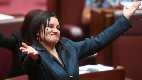 She reacts after delivering a statement on her resignation in the Senate chamber (Image: AAP)