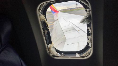 A photo of the window blown out by the exploding engine on the Boeing 7373 bound from New York to Dallas. (Facebook)