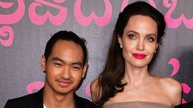 Maddox Jolie-Pitt and Angelina Jolie.