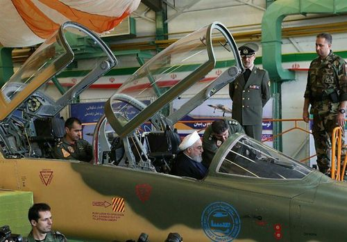 Iran's President Hassan Rouhani sits in the front seat of the Kowsar.