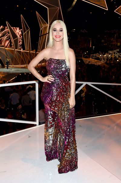<p>Katy Perry's hosting had a mixed response at this year's MTV VMAs in LA but her outfit changes kept us watching.</p> <p><strong>Look 1</strong></p> <p>Here in Halpern Perry gives us glitter.</p>