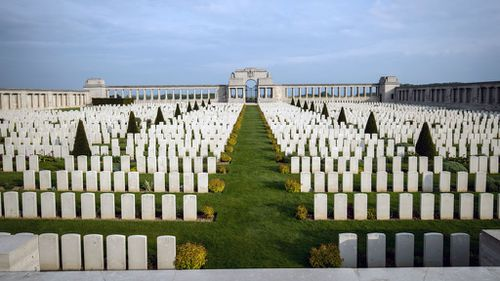 The evening sun illuminates headstones in the Pozieres British Cemetery on May 16, 2016 near Albert, France. (Getty)