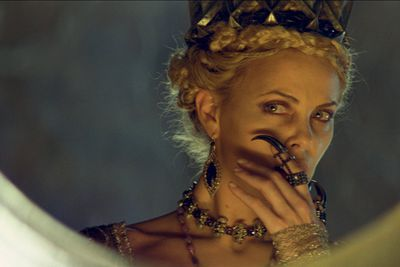 Charlize Theron as Queen Ravenna.