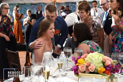 Guests were quick to help the bride while they waited for an ambulance.