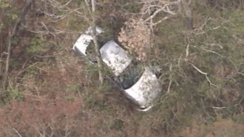 Car slides 80m down hill at Queensland lookout