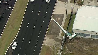 A crane is toppled in the wild weather.