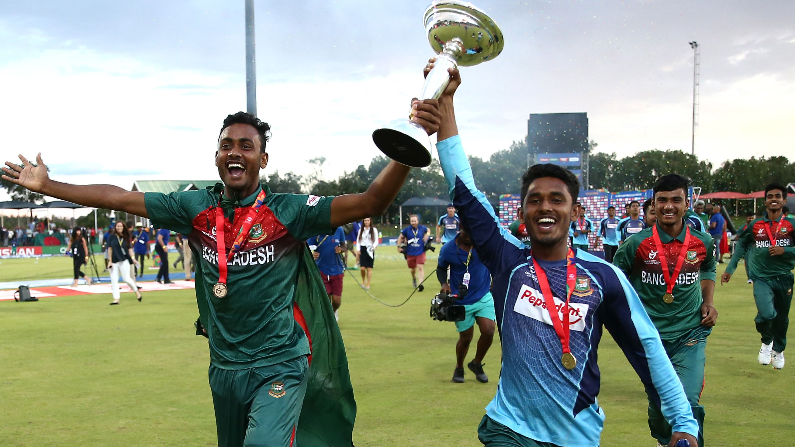 Bangladesh players celebrate with the U19s World Cup trophy.
