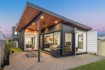 Two-storey shipping container home in Brisbane draws big