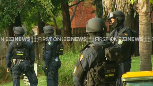Police at the home in Wentworthville, where two people were arrested. (9NEWS)