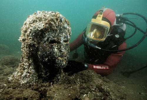 One of the finest finds in Abukir Bay is the remarkable dark stone statue of a 3rd century Ptolemaic queen, very probably Cleopatra II or Cleopatra III, wearing the tunic of the goddess Isis. Picture: Franck Goddio/Hilti Foundation/Christoph Gerigk