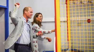 Britain's Prince William and Kate, the Duchess of Cambridge play a game at an amusement arcade, where TV program Gavin and Stacey was filmed, in Barry Island, Wales, Wednesday Aug. 5, 2020, during their visit to speak to local business owners about the impact of COVID-19.