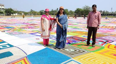 The 11,148 square metre bedspread is as big as one and a half football fields, shattering the previous Guinness World Record of 3377 square metres.