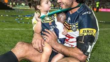 Johnathan Thurston with daughter Frankie after the Cowboys' Grand Final win. (NRL)