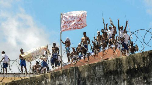 Inmates riot on the roof of a prison in Natal, Brazil. (AAP)