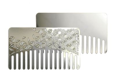 Choose a dual-purpose comb in a reflective stainless steel that not only slips into a credit card holder but offers a discreet, unexpected mirror.