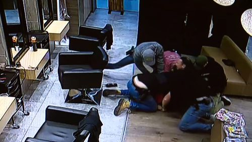 One officer can be seen punching the suspect multiple times as they try to restrain him. Picture: Supplied