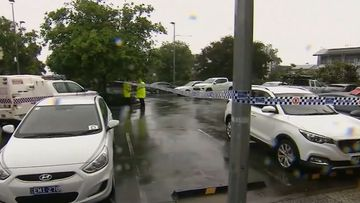 Police tape off the crime scene on the Gold Coast where two men were found stabbed.