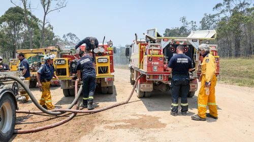 Firefighters will today continue to battle the Captain Creek bushfire after residents in Winfield were evacuated overnight amid a strong wind change.