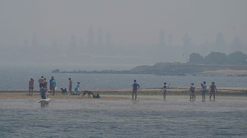 Smoke haze from bushfires is seen at Brighton Beach in Melbourne, Friday, January 3, 202