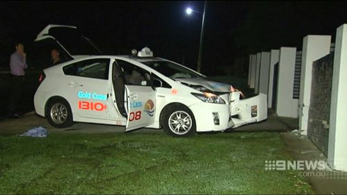 The taxi driver attempted to flee the attacker but crashed into a wall. (9NEWS)
