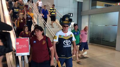 NRL fans make their way from Sydney Airport, after a full-capacity flight touched down. (9NEWS / Darren Curtis)