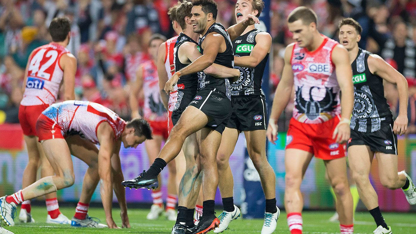 Courageous Collingwood win marred by Daniel Wells knee injury on AFL return