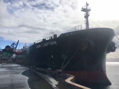 Iron Chieftan was unloading iron ore in the early hours of this morning when a conveyor belt caught alight. Picture: Supplied.