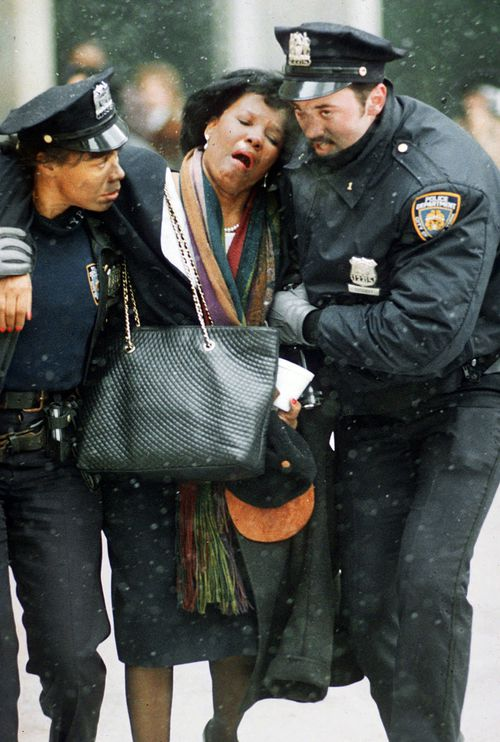 In this Feb. 26, 1993 file photo, two New York City police officers help an injured women away from the scene of the World Trade Center truck bomb attack. It was a terror attack that foreshadowed Sept. 11: the deadly World Trade Center bombing that happened 25 years ago Monday. (AP Photo/Joe Tabacca, File)