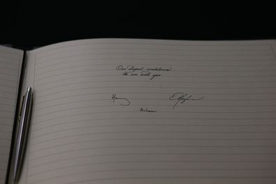 Meghan and Harry sign a book of condolence after last weeks terrorist shootings in New Zealand.