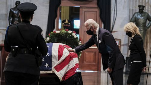 Joe Biden bids farewell to John Lewis at a memorial at the US Capitol.