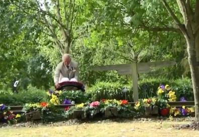 Prince Charles lays a wreath.