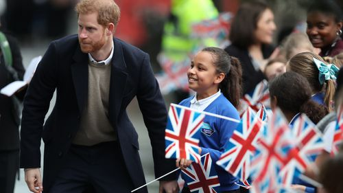 Sophia was waving a British flag when Prince Harry approached her. (PA/AAP)