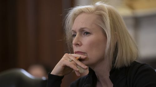 Democrat Kirsten Gillibrand listens to Senator Martha McSally's testimony.