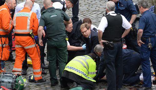 MP Tobias Ellwood tried to resuscitate PC Palmer. (AP/AAP)
