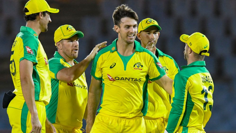 Mitchell Marsh is congratulated after taking a wicket as the Aussies reduced the West Indies to 6/145 from their 20 overs.