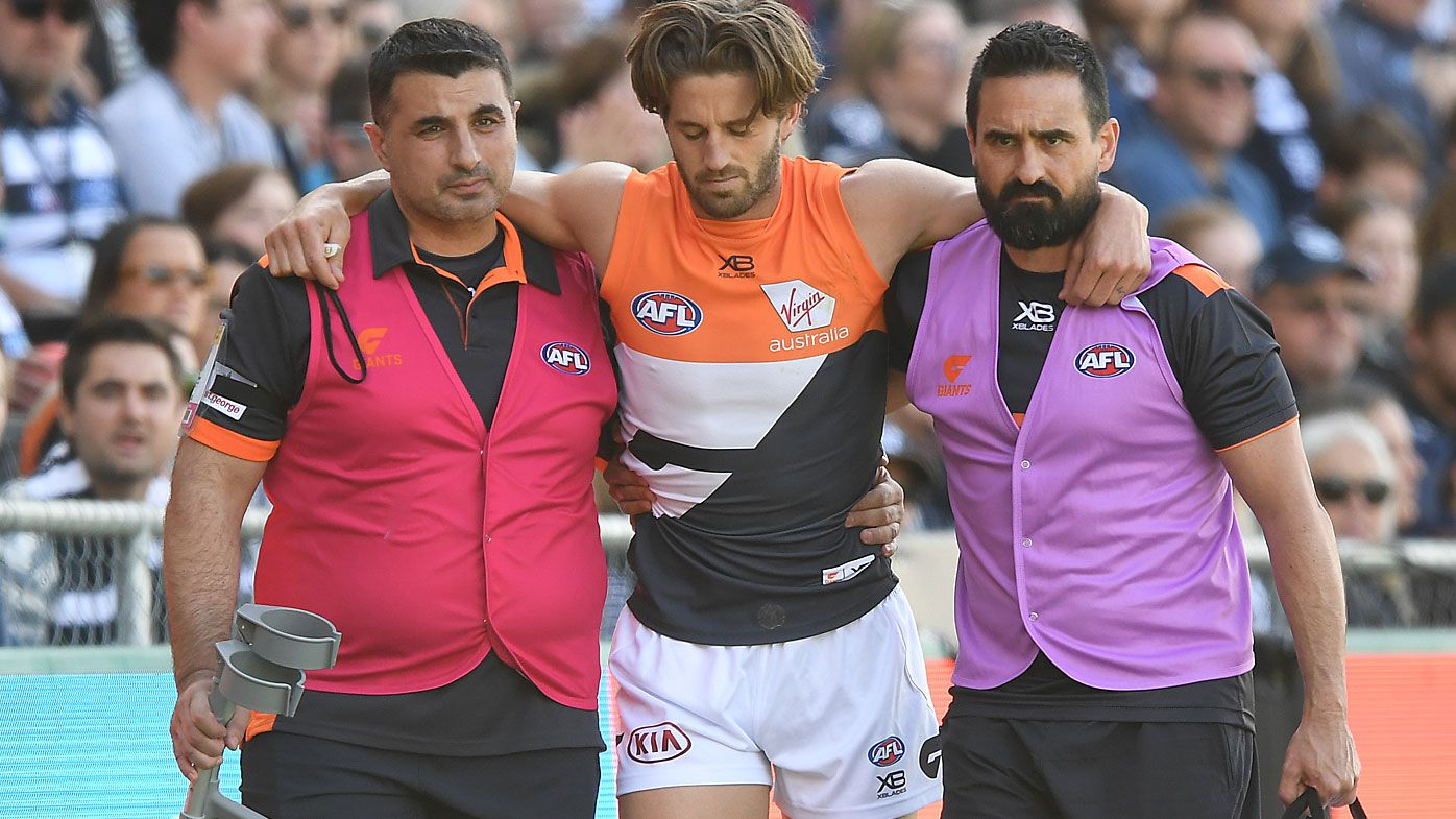 GWS Giants co-captain Callan Ward in tears after suffering second knee injury in AFL return