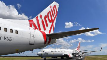 Grounded Virgin Australia aircraft are seen parked at Brisbane Airport in Brisbane