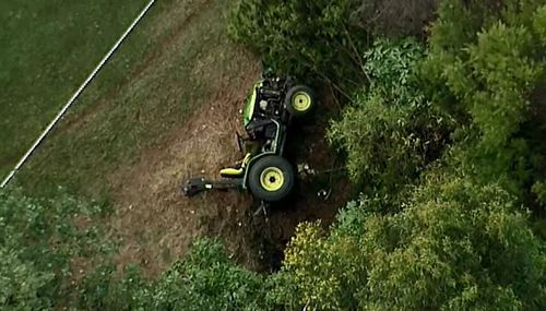 Man becomes trapped under tractor at Brisbane golf course