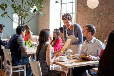 Waitress serving table.