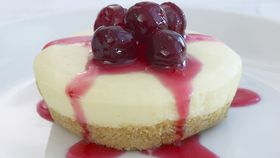 Vanilla cheesecakes with cranberry syrup