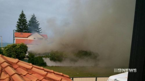 """Neighbours said the smoke and flames were """"intense"""". (9NEWS)"""