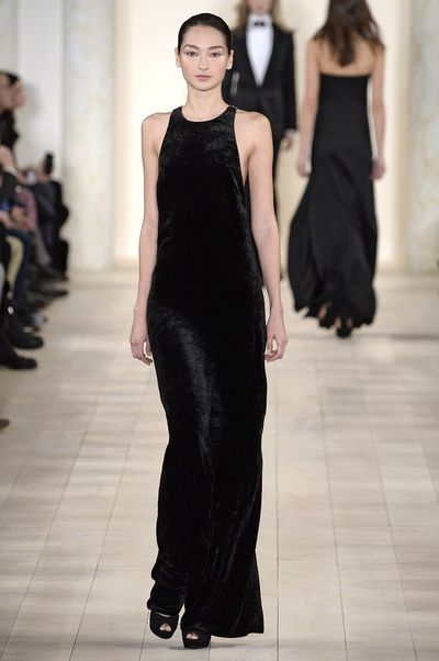 <p>Next, velvet appeared on the Fall '15 ready-to-wear runways in February and March. Ralph Lauren's used the fabric for his va-va-voom via figure-hugging dresses.</p>