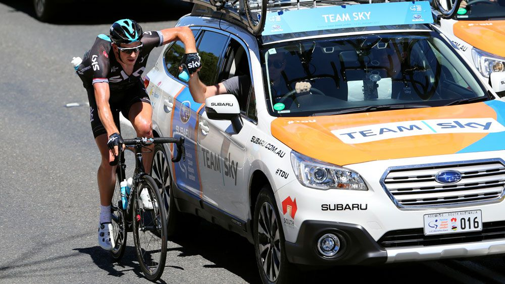 Team Sky help one of their riders during stage three of the Tour Down Under on Thursday. (Getty Images)