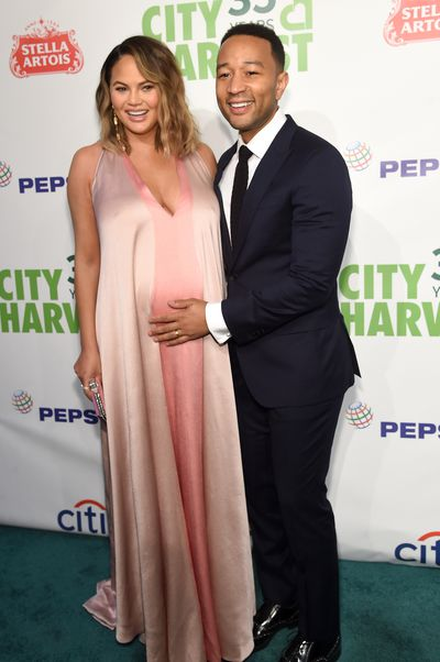 Chrissy Teigen, in Valentino, and husband John Legend at City Harvest's 35th Anniversary Gala in New York in April, 2018