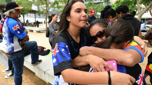 Family of one-punch victim Trevor Duroux embrace outside the Supreme Court. (AAP)