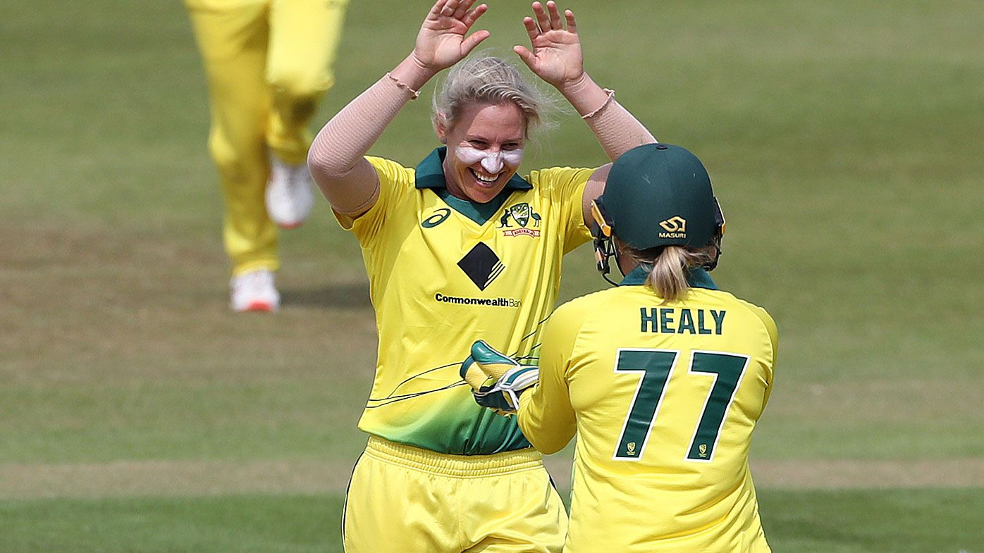 Australia's Delissa Kimmince celebrates taking the wicket of England's Natalie Sciver with Alyssa Healy during the Second One Day International match of the Women's Ashes Series