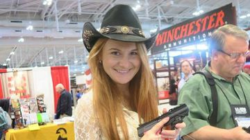 Mariia Butina poses with a pistol at a gun show. (Facebook)