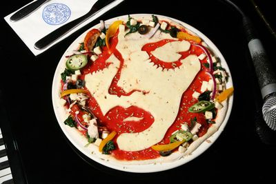 UK pizza chain, Pizza Express, created a line of cheesy-portraits for all those music fans out there. We reckon they captured bad girl <b>Rihanna</b> pizza perfectly!